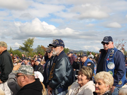 Veterans stand during a Veterans Day musical tribute Saturday as the Sequoia Middle School band plays service songs.