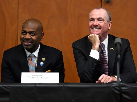 Newark Mayor Ras Baraka, left, and Governor Phil Murphy