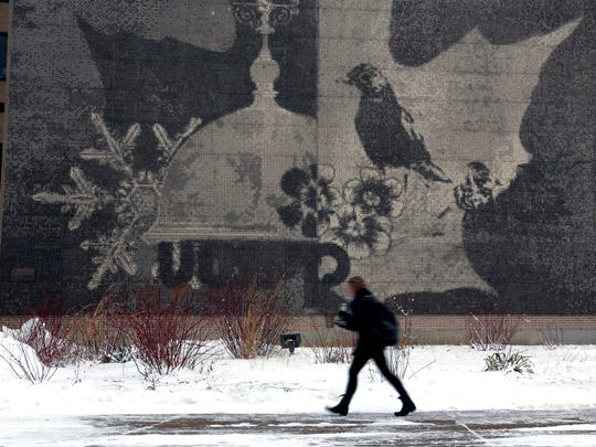 A student walks past a mural at the University of Wisconsin-Stevens Point Jan. 23, 2018, in Stevens Point.