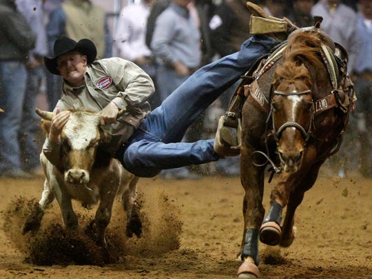 Sam Powers of Sonora competes in steer wrestling during slack for the 2013 San Angelo Stock Show & Rodeo.