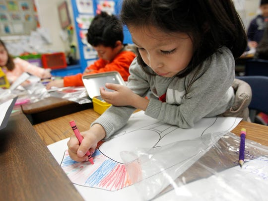 Windsor Park Elementary School student Dayanara Brem, 8, colors an Egyptian headdress on Tuesday while learning about Egypt. Students will rotate through seven stations January 21, 2014 to learn about different countries.