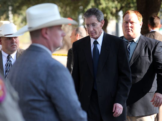 Warren Jeffs is escorted to the side entrance of the