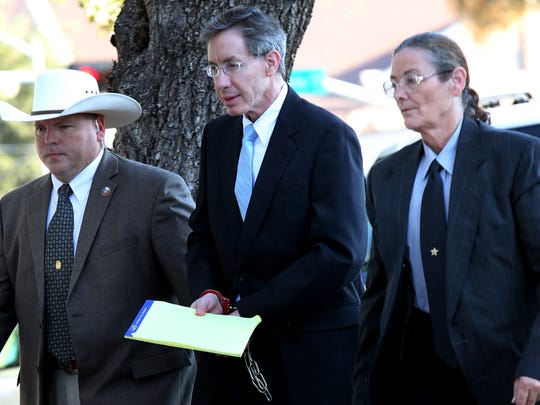 Warren Jeffs is taken into the side entrance of the