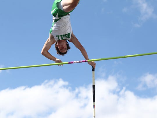 Wall High School pole vaulter Garrett Stephens clears the bar at the Cotton Patch Relays in Wall on Thursday, March 29, 2018.