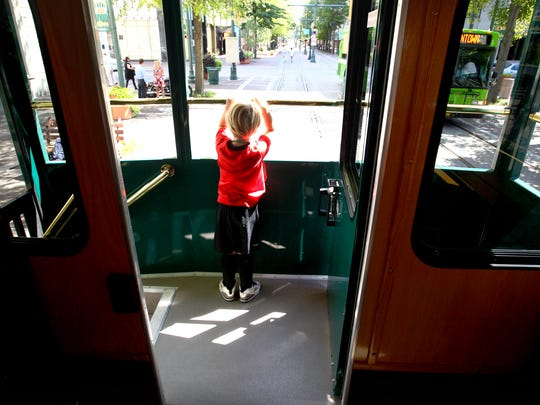 "Jul 31, 2015 -  Finch Avant, 4, checks out the view from the rear platform during an unveiling for the new MATA Trolley buses that will replace the green hybrid buses on the trolley lines. ""These trolley buses, while attractive, are the interim step in bringing the real vintage trolleys back,"" said Ron Garrison, MATA President and General Manager. ""Are they better than big green buses? Yes. Are they as attractive and iconic as real rail trolleys? They are close. We needed to buy some smaller buses so this step makes financial and aesthetic sense. We believe this will be good for residents, businesses and their employees, not to mention tourists.""