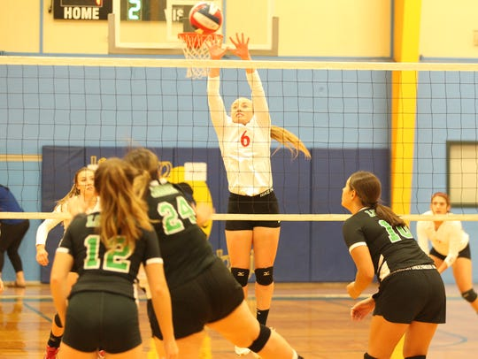 Miles High School's Skyler Brooks (6) and the Lady