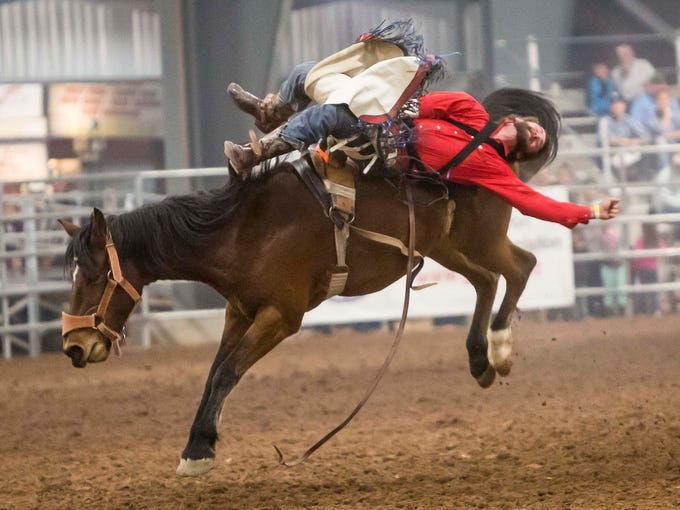 TJ Spoonhunter rides in the bareback section of the