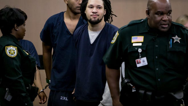 Curtis Jenkins is led away after pleading guilty to lesser charges in the fatal shooting of John Roland with his attorney Scott Skier at the Palm Beach County Courthouse in West Palm Beach on Tuesday, August 6, 2019.