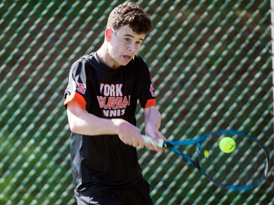 York Suburban's Parker Lando returns the ball to Littlestown's Noah DeCampo during the AA championship match at the YAIAA Championships, Saturday, April 28, 2018. Lando won the match, 6-0, 6-1.