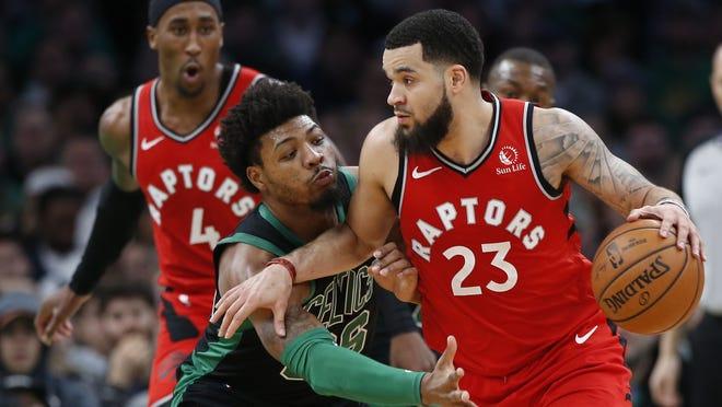 Toronto Raptors guard Fred VanVleet (23) keeps the ball from Boston Celtics guard Marcus Smart (36) during the second half at TD Garden on Dec. 28, 2019.