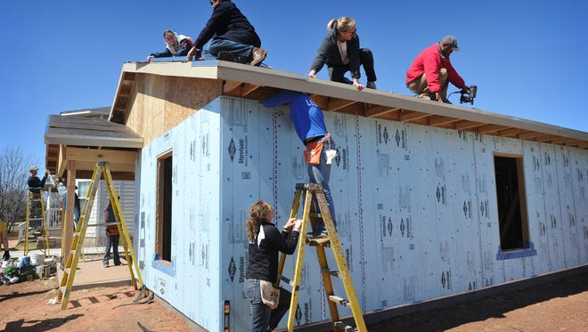 College students from the University of Jamestown in North Dakota and Washington University in St. Louis are spending a week of Spring Break helping build a Habitat for Humanity home on Fort Worth Street. Part of the HOME program funds aid Habitat house recipients.