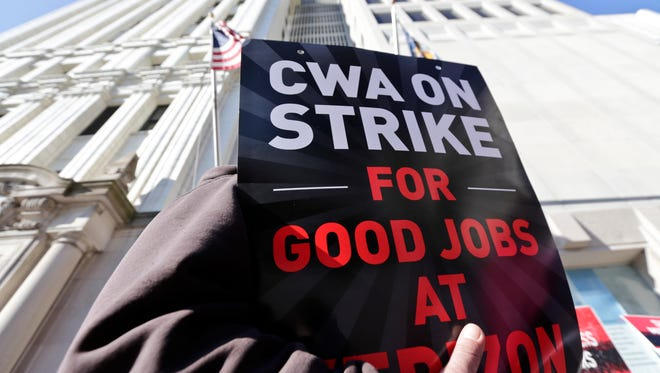 Striking Verizon workers picket outside a Verizon office 2016 in Albany, N.Y.