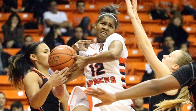 UTEP junior guard Sparkle Taylor, 12, gets the ball stripped away by Catarina Rendon of UT-Permian Basin as she drives for a layup Monday night in the Don Haskins Center.