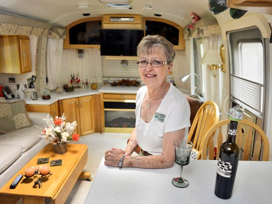 Linda Agre says she likes the build quality and amenities of her Airstream trailer. Inside there's an electric fireplace, leather couch and a lot of hickory trim. Agre describes her 34-foot, 2003 Classic Limited Airstream as one that sleeps two, feeds four and entertains six. The rig cost about $103,000.