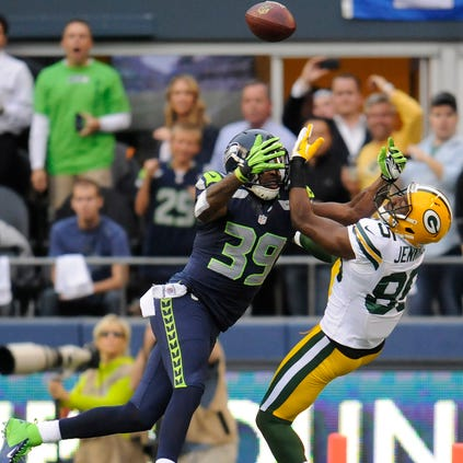 Packers receiver Greg Jennings (85) tries to catch a pass with Seahawks defender Brandon Browner closing in during the teams' Sept. 24, 2012 game in Seattle. The Seahawks secondary's physical style of play has prompted the league to take a closer look at holding and illegal use of hands violations.