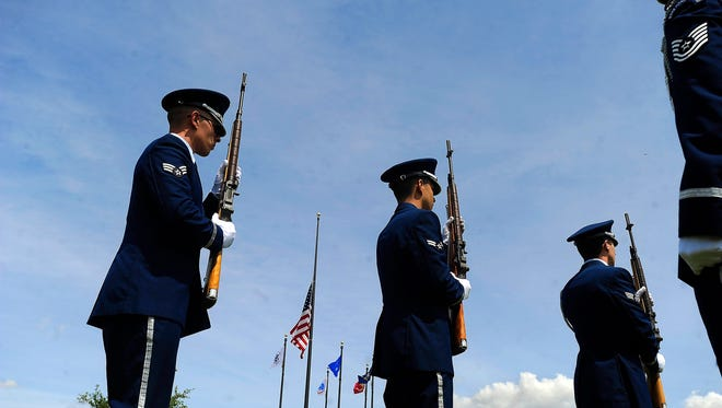 Members of the Dyess Air Force Base Honor Guard perform a 21-gun salute during last year's Memorial Day ceremony at the Texas State Veterans Cemetery at Abilene.