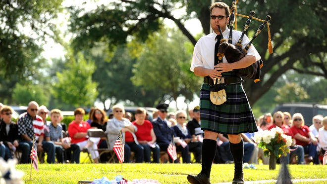 "Abilene Pipers member Lynn Blair plays ""Amazing Grace"" during the Memorial Day ceremony May 29 at Elmwood Memorial Park."