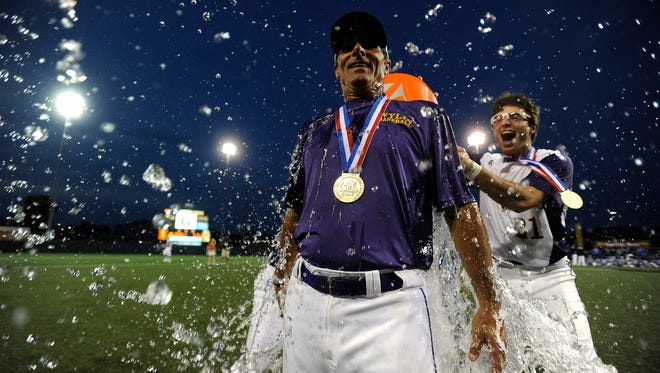 Wylie head coach Clay Martin  gets doused with water by his son, Gatlin,  after the Bulldogs' 6-5 win over Robinson in the Class 4A state championship game on Thursday, June 8, 2017, at Disch-Falk Field in Austin.
