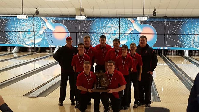 The Sandusky boys bowling team poses with their Division 4 state championship trophy.