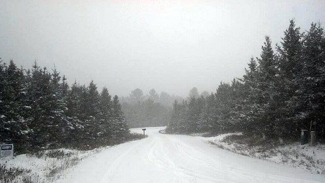 Snow falls southwest of Rhinelander as the first winter storm of the season moves into NW Wisconsin.