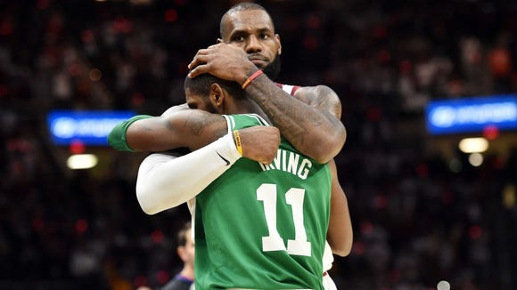 Isaiah Thomas and Kyrie Irving hug after Celtics beat Cavs in Boston