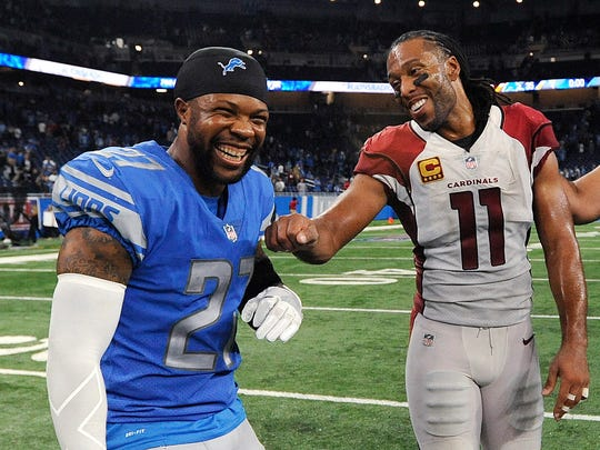 Detroit Lions free safety Glover Quin (27) and Arizona Cardinals wide receiver Larry Fitzgerald (11) laugh together after a NFL football game in Detroit, Sunday, Sept. 10, 2017. Detroit won 35-23. (AP Photo/Jose Juarez)