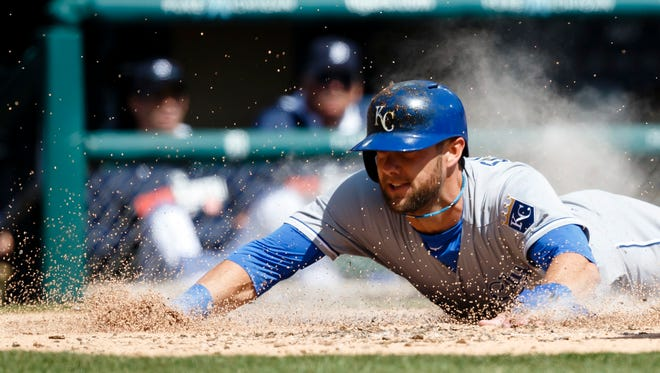 Kansas City Royals left fielder Alex Gordon slides into home safe against the Detroit Tigers during an opening day baseball game at Comerica Park.