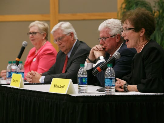Candidates for Utah House District 74, Dorothy Engelman (D) and Lowry Snow(R) and District 75 candidates Don Ipson¨ and Nihla Judd (I), from left to right debate the issues Monday, Sep. 22, 2014 on the campus of Dixie State University.