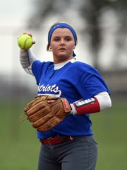 Union County's Rachel Sparks throws a ball between innings Tuesday, April 11, 2017, during a softball game in Winchester.