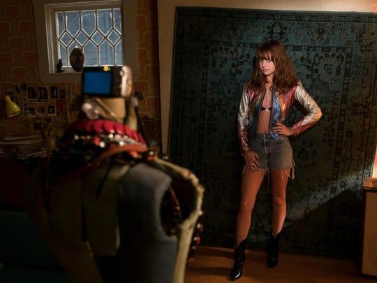 Sophia (Britt Robertson) snaps pictures for her eBay site in a scene from Netflix' 'Girlboss.'