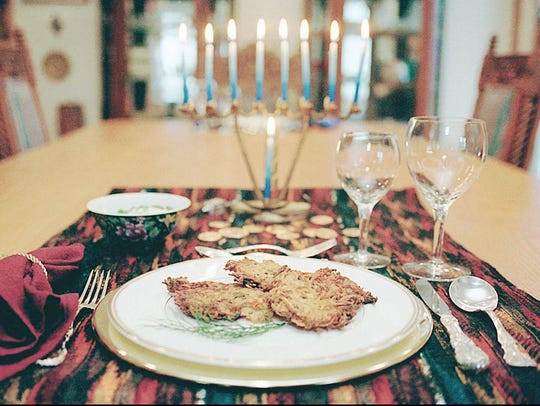 Hanukkah's signature dish is the potato latke, or pancake, usually served with sour cream or applesause.