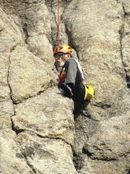 Rob Kelman climbing Devil's Tower.
