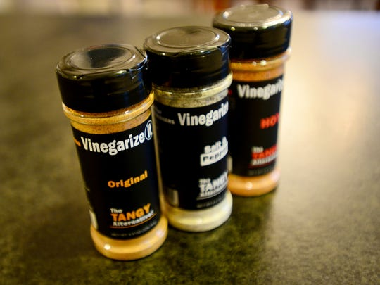 Eric and Val Harrell, along with their children Alissa, 11, and Ryan, 9, have created a food seasoning called Vinegarize-It. They will be donating a portion of sales to Autism Speaks.
