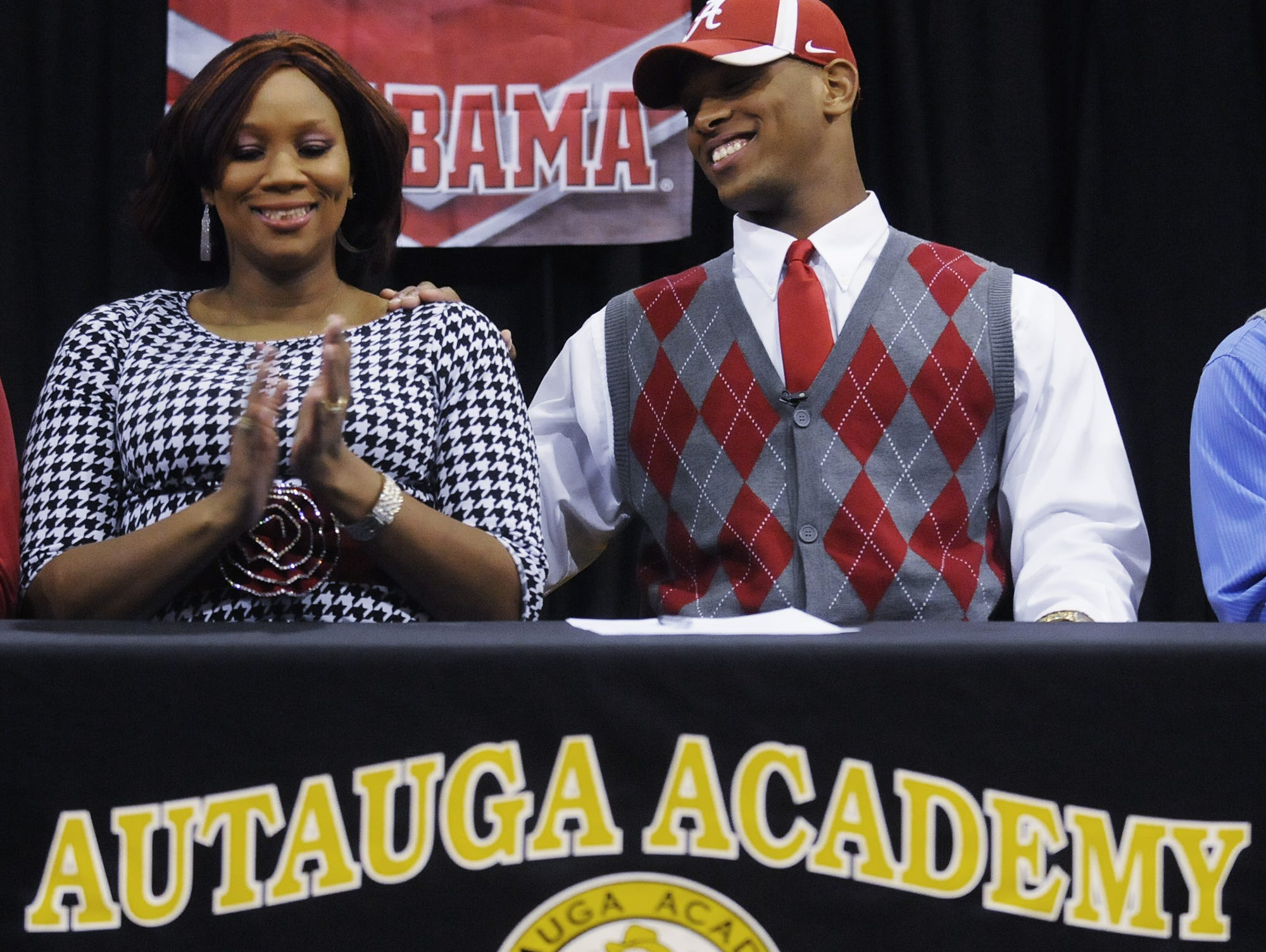O.J. Howard, who is rated the No. 1 tight end in the country, sits with his mother Lamesa Parker-Howard as he is honored at a ceremony at Autauga Academy on Thursday. Photos by Mickey Welsh/Advertiser Autauga Academy's O.J. Howard sits with his mother Lamesa Howard as he is honored at a ceremony at the school in Prattville, Ala. on Thursday December 13, 2012. Howard will start school at the University of Alabama in January.(Montgomery Advertiser, Mickey Welsh)
