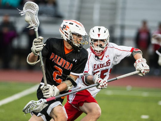 Palmyra's Grant Haus works to get by Cumberland Valley's Maxwell Seeber.