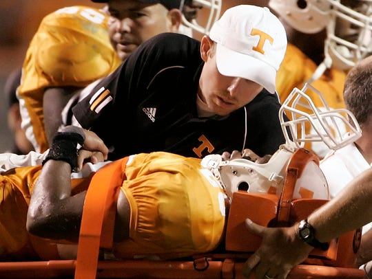 Tennessee cornerback Inky Johnson is taken off the