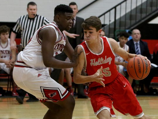 Holliday's Tucker Strealy drives to the basket while