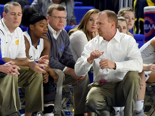 Westview head coach Brian Haskins talks with Westview's Tasia Jones on the bench during the 2018 Class AA semifinals, Friday, March 9, in Murfreesboro.