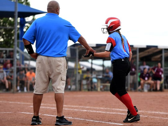 Gibson County's Jaci White gets a hand slap from her