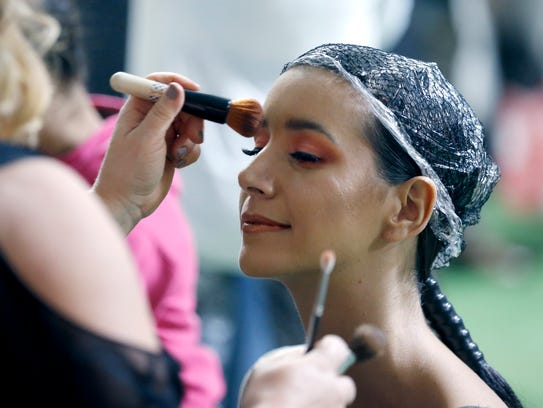Sara Otero of Brighton gets makeup before the runway