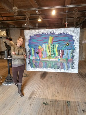 """Kelley DeCoste of Howell with her ArtPrize 10 entry, """"Rising from the Ashes,"""" on display at the Harris Building in Grand Rapids through Oct. 7."""