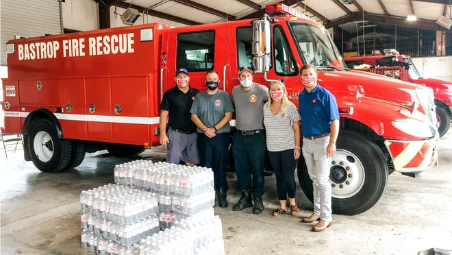 Bastrop Fire Department Station 2 in Tahitian Village - left to right: Roger Richards (The Steam Team), firefighter Josh Kingston, firefighter Caleb Gay, Ashtynn Bennett (The Steam Team) and Kevin Klaus (The Steam Team).