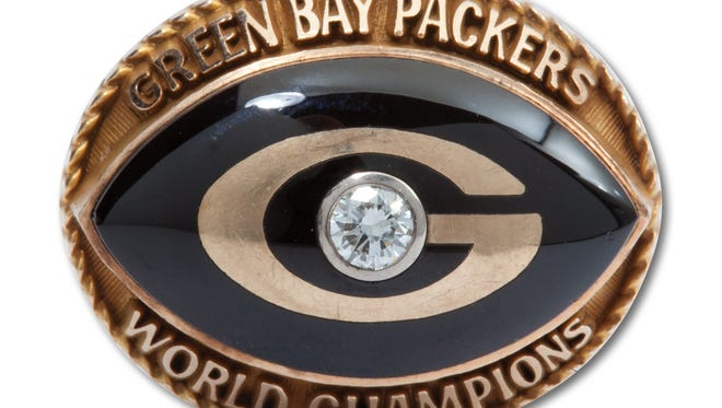 Vince Lombardi's 1960s Green Bay Packers 14-karat gold and diamond cuff link.