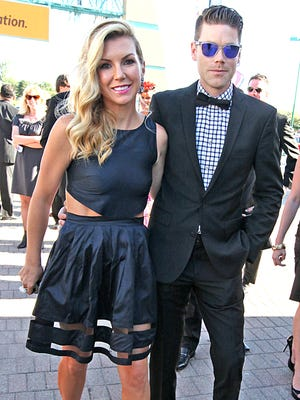 Jarrod Krisiloff, senior director of marketing for the Indianapolis Motor Speedway and wife, Megan Krisiloff, looking quite dapper as they enter the Zoobilation festivities.