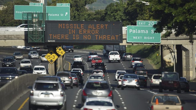 """A sign on the H-1 Freeway in Honolulu lets people know that the missile alert was a false alarm. AP In this Saturday, Jan. 13, 2018 photo provided by Civil Beat, cars drive past a highway sign that says """"MISSILE ALERT ERROR THERE IS NO THREAT"""" on the H-1 Freeway in Honolulu. The state emergency officials announced human error as cause for a statewide announcement of an incoming missile strike alert that was sent to mobile phones. (Anthony Quintano/Civil Beat via AP)"""