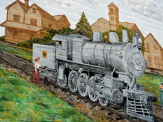 The side of Marlin's Auto Center building in New Freedom features a train mural. Examples of outdoor art around York County, taken on Wednesday, July 2, 2014, for Flipside. Chris Dunn -- Daily Record/Sunday News