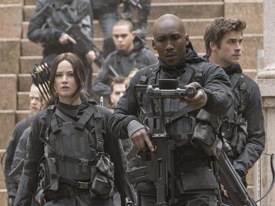 "Katniss Everdeen (Jennifer Lawrence, left), Boggs (Mahershala Ali, center) and Gale Hawthorne (Liam Hemsworth, right) in ""The Hunger Games: Mockingjay - Part 2."""