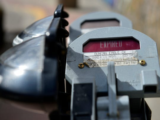 Downtown Great Falls parking meters being serviced Thursday afternoon.