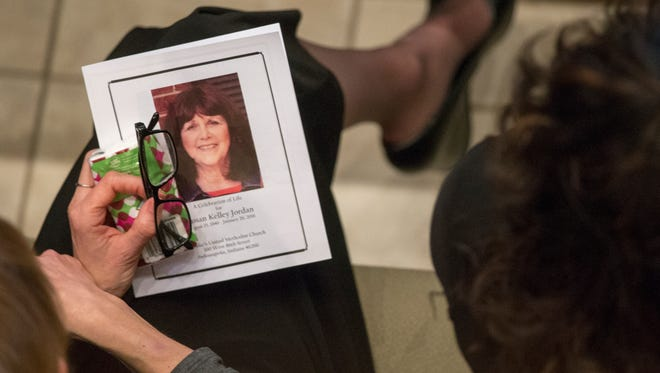 A program sits on the lap of a well-wisher Jan. 30, 2016, at a memorial at St. Luke's United Methodist Church for Susan Jordan, who died in a recent school bus accident at Amy Beverland Elementary School, where she served as principal.