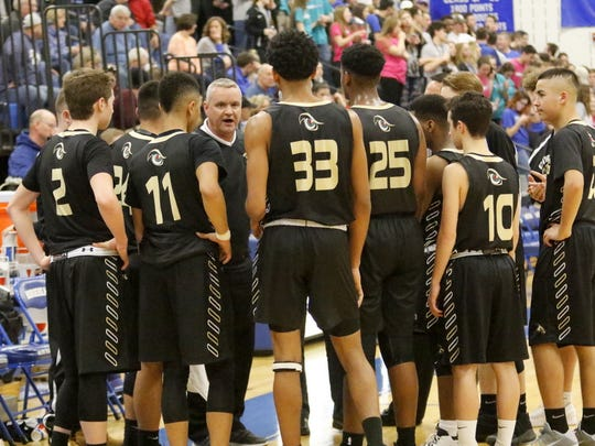 John Fesetch talks to his team during a win over Horseheads in 2016-17. The Hawks won the Section 4 Class AA title that season under Fesetch.